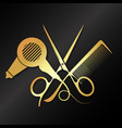 golden scissors and comb with hair dryer