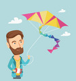 young man flying kite vector image vector image