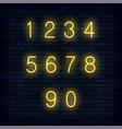 set of yellow neon numbers vector image