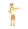 young smiling man with backpack standing with a vector image vector image