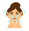 young woman washing her face with clear water vector image vector image
