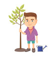 caucasian smiling boy planting a tree vector image