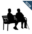 two elderly woman silhouettes sitting on a bench vector image