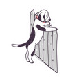 cute dog trying to climb over fence and escape vector image vector image