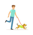 young smiling man walking a dog vector image