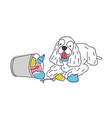 cheerful dog dumped trash out of litter bin or vector image vector image