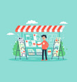flat young man newsagent in newsstand sells vector image