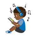 Boy reading text from tablet and listening to