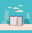 text book and pencil with forest landscape vector image
