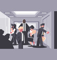 Businessmen and businesswoman waiting for elevator