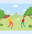 two girls having fun playing badminton together vector image vector image