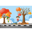 two boys raking dried leaves on pavement vector image vector image