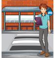 A man holding a book near the bus stop vector image vector image