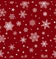 Seamless pattern of snowflakes white on red