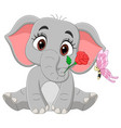 cute baby elephant sitting with flowers and butte