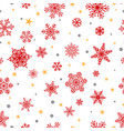 Seamless pattern of snowflakes red on white