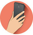 hand holding mobile phone in flat design style vector image vector image
