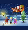 happy kids singing in the snowing village with san vector image vector image
