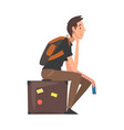 man sitting on suitcase waiting for departure guy vector image vector image
