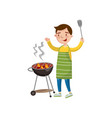 cheerful man preparing barbecue on the barbecue vector image vector image