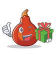 with gift red kuri squash mascot cartoon vector image