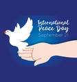 international day peace lettering with hand and vector image vector image