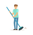 young smiling man sweeping the floor house vector image