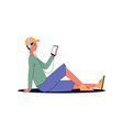 man sitting on floor with headphones listening vector image vector image
