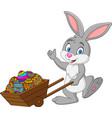 cartoon rabbit pushing cart full easter eggs vector image vector image