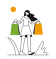 shopping girl with bags walking down the street vector image