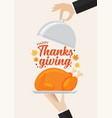waiter serving a turkey with happy thanksgiving vector image