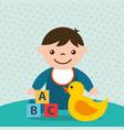 cute toddler boy blocks alphabet and duck toys vector image