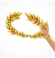 golden laurel wreath in human hand vector image vector image