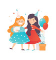 two cute girls celebrating birthday cheerful vector image vector image