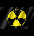 yellow radiation sign on black background vector image