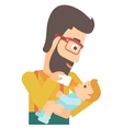 man feeding baby vector image vector image