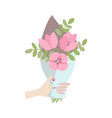 a male hand gives spring bouquet of flowers vector image
