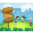 Three kids playing in the garden with wooden vector image vector image