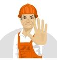 road worker in hard hat showing stop gesture vector image vector image