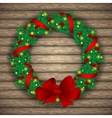Christmas wreath with baubles and treeon vector image