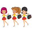 Three women with shopping bags vector image
