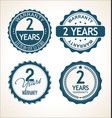 two years warranty retro vintage badge and labels vector image vector image