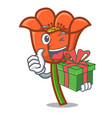with gift poppy flower mascot cartoon vector image