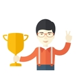 Asian man standing while holding his trophy vector image