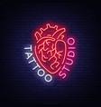 tattoo studio logo neon sign symbol human vector image