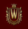 golden royal coat of arms with w monogram vector image