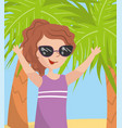 young happy woman in sunglasses against a palm vector image