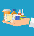 medical pills and bottles in hand of doctor vector image vector image
