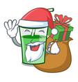 santa with gift green smoothie mascot cartoon vector image vector image