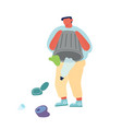 man dumping garbage on ground or in water trowing vector image vector image